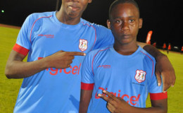 Jaleel Hamilton (left) and Ryan Hackett of Chase Academy are all smiles following their easy semi-final win over Annai Secondary at the Leonora Sports Facility yesterday.
