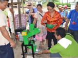 Minister Valerie Garrido-Lowe demonstrating the use of one of the four cassava mills. (GINA photo)