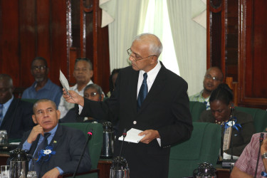 Minister of Communities Ronald Bulkan referring to a report in the Mirror newspaper during yesterday's debate. (Keno Henry photo)