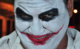 In face paint as Batman's nemesis the Joker
