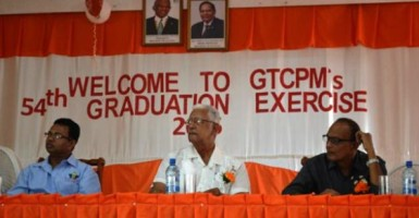 Agriculture Minister  Noel Holder (centre) and GuySuCo's Chief Executive Officer (ag) Paul Bhim (right) among those at the head table at the corporation's 54th Apprenticeship Graduation. (GINA photo)