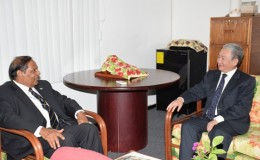 Prime Minister, Moses Nagamootoo (left) and Chinese Ambassador to Guyana,  Zhang Limin engaged in discussions during the courtesy call (GINA photo)