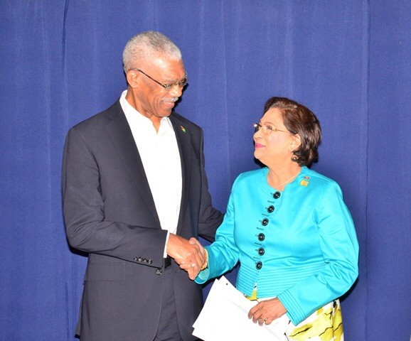 President David Granger and Trinidadian Prime Minister Kamla Persad-Bissessar (Photo via GINA)