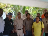Permanent Secretary of the Department of Natural Resources and the Environment, Joslyn McKenzie (immediate left), Minister of Governance, Raphael Trotman (centre back row), Advisor to the Department, Clayton Hall (immediate right) and Commissioner of the Protected Areas Commission, Damian Fernandes (in orange) with the Representatives and Toshaos of Region 9's KMRDG.