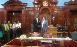 Photo shows Jessica Faieta (right) with Speaker Barton Scotland in Parliament Chambers. (Parliament Office photo)
