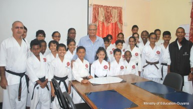 Students of the Guyana Karate College paying a courtesy call on Minister of Education, Dr. Rupert Roopnaraine (centre). Some of the students are heading to the 2015 Karate World Cup in Toronto, Canada on July 15-19.  (Ministry of Education photo)