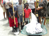 Residents of the Shopping Plaza Community Development Group with their tools.