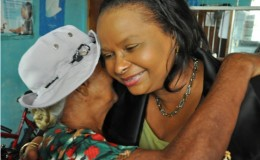 Minister of Social Protection, Volda Lawrence receives a hug from a pensioner (GINA photo)