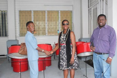 In this photo Minister Nicolette Henry (centre)  makes the symbolic handover to Tracey Heyligar, Headmistress of Berbice High School.