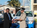 Minister of Public Security Khemraj Ramjattan (left) making the presentation to Commissioner   of Police Seelall Persaud.