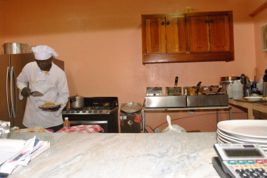 Island style Chef Omar doing his thing in the Kitchen