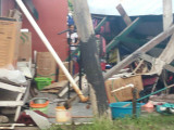 The destroyed shed with the items scattered