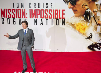 U.S. actor Tom Cruise poses for photographers at a British screening of the film 'Mission Impossible: Rogue Nation' in London, Britain July 25, 2015. REUTERS/NEIL HALL