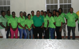 The national women's team pose with GCB president Drubahadur along with Coach Andre Percival and  GCB Selector Rayon Griffith far right (second and last to right)