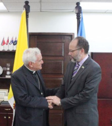 Secretary-General of the Caribbean Community Ambassador Irwin LaRocque (right) accepting the credentials of the first ever Ambassador of the Vatican to the Community, Archbishop Nicola Girasoli. (CARICOM photo)