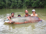 The Rewa team (l to r): Trevor Chan, Jaia Paul, Duane de Freitas Jr, Lesley de Souza engaged with Mr Arapaima.
