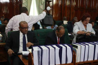 From left are Opposition Leader Bharrat Jagdeo, Clement Rohee and Gail Teixeira in parliament yesterday (Keno George photo)