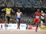 Sprint sweep for brilliant Bolt in Beijing: Usain Bolt of Jamaica (L) crosses the finish line ahead of Justin Gatlin (2nd R) from the U.S., Zharnel Hughes of Britain (2nd L) and Ramil Guliyev of Turkey in the men's 200m final during the 15th IAAF World Championships at the National Stadium in Beijing, China yesterday. Reuters/Lucy Nicholson