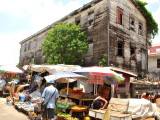 Not budging! Vendors trading in the shadow of the old  Bedford School