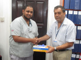 In photo Dr. Aftaab Aliahmad (left) is seen with GPHC's Chief Executive Officer,  Michael Khan