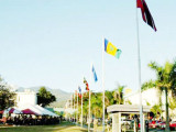 Flags fly on the lawns near the Assembly Hall at University of the West Indies, Mona, in 2010. UWI and CCHEC will sign an agreement for the redevelopment of areas of the campus, priced at around $40 billion.