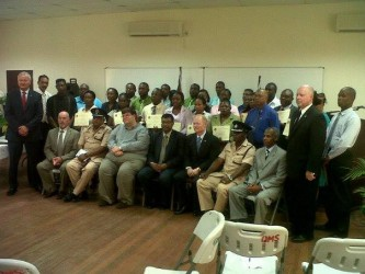 Third from left in front row, US Chargé d'Affaires Bryan Hunt, Minister Khemraj Ramjattan and other officials along with beneficiaries of the training programme.