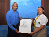 President David Granger yesterday received an artistic representation of his image sketched by Jѐsusa Lee. Lee is a student of Queen's College in the upper sixth form level. (Government Information Agency photo)