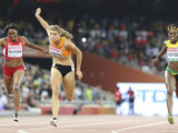 Dafne Schippers of Netherlands (C) celebrates as she crosses the finish line to win the women's 200 metres final during the 15th IAAF World Championships at the National Stadium in Beijing, China yesterday. REUTERS/DYLAN MARTINEZ
