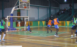 Gerald Gittens (2nd from right) in the process of scoring his side's third goal during their win over Beterverwagting (BV) in the GT Beer Futsal Championship at the Cliff Anderson Sports Hall