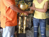 Organizer of the President's Cup, Fazal Habibulla receiving the championship trophy yesterday from Devi Sunich.