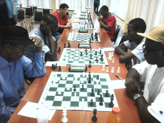 Chess players competing for honours during the 2015 Forbes Burnham Memorial Chess Tournament which ends today at the National Racquet Club on Woolford Avenue. Leaders after three rounds of the competition are Roberto Neto, Anthony Drayton and Taffin Khan.