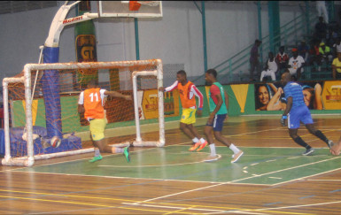Dwayne Lawrence (no.11) of Festival City scoring the fastest goal in the tournament in 18 seconds during his team's victory against Kitty Weavers in the GT Beet Futsal Championship