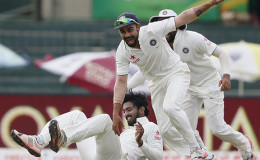 India's captain Virat Kohli (C) celebrates with Lokesh Rahul (bottom) after taking the catch to dismiss Sri Lanka's Dinesh Chandimal (not pictured) during yesterday's fourth day of their third and final test cricket match in Colombo.REUTERS/DINUKA LIYANAWATTE
