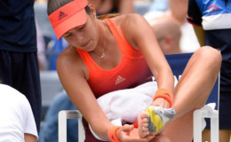 Ana Ivanovic of Serbia treats a blister while playing Dominika Cibulkova of Slovakia on day one of the 2015 US Open tennis tournament at USTA Billie Jean King National Tennis Center yesterday. Mandatory Credit: Robert Deutsch-USA TODAY Sports.