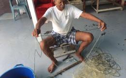 Seerajeo Persaud knitting a fishnet