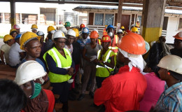 Minister Simona Broomes interacting with workers of the Barama Buckhall operations (GINA photo)