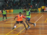 Okeene Fraser of Bent Street trying to maintain possession of the ball while being challenged by North Ruimveldt's Joshua Browne during their group-D affair in the GT Beer Futsal Championship