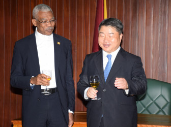 President David Granger (left) and South Korea's non-resident Ambassador to Guyana, Maeng Dal Young in dialogue on Wednesday at the Ministry of the Presidency (Ministry of the Presidency photo)