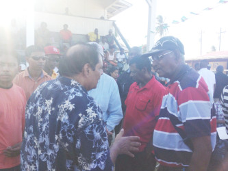 Prime Minister Moses Nagamootoo interacting with a resident at Whim yesterday.
