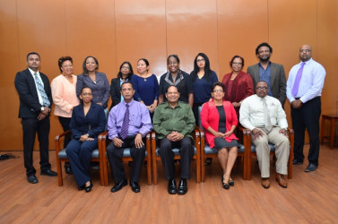 Newly appointed board members of Guyana National Newspapers Ltd (GNNL) and National Communi-cations Network (NCN) pose with Prime Minister Moses Nagamootoo. From left standing are: Sohan Poonai, Margaret Lawrence, Carolyn Walcott, Dhanwanti Sukhdeo, Dr Paloma Mohamed, Karen Davis, Scherazade Ishoof-Khan, Patricia Woolford, Ruel Johnson and Imran Khan.Sitting from left are: CEO of NCN Molly Hassan, NCN - Board of Directors Chair Bishwa Panday, Nagamootoo, GNNL Board of Directors Chair Jean La Rose and Chronicle General Manager Michael Gordon. Missing from photo are: Board Members Bert Wilkinson, Tabitha Sarabo, Mark Archer, Kojo McPherson and Colin Thompson.