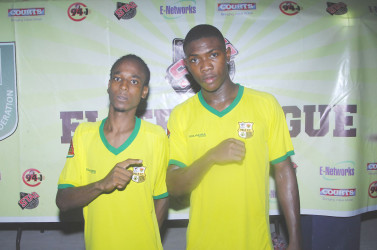 Pele goal scorers Deon Alfred (left) and Jumane Somerset pose for a photo opportunity following their hard-fought win over GFC in the GFF Stag Beer Elite League tournament opener at the Leonora Sports Facility (Orlando Charles photo)