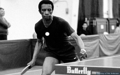 George Braithwaite plays a forehand loop against Danny Seemiller (not in picture)