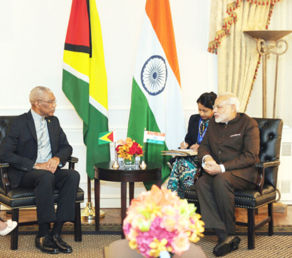 President David Granger in discussion with India's Prime Minister Narendra Modi, whom he briefed on Guyana's ongoing border controversy with Venezuela at the Waldorf Astoria Hotel, New York. (Ministry of the Presidency photo)