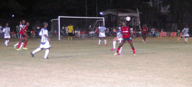 Alpha United's Sherwin Skeete (red) battling with GFC's Shad Fernandes for possession of the ball during their team's matchup at the GFC ground in the GFF Stag Beer Elite League