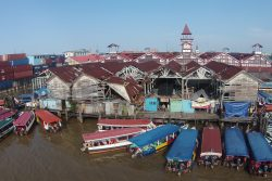 Water taxis parked around the dilapidated Stabroek Market Wharf. At serious risk to life and limb, several persons still vend on the wharf. (Photo by Keno George)