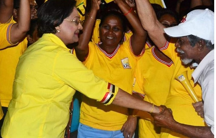 Former PM Kamla Persad-Bissesssar greets her supporters on Tuesday following Monday's General Elections