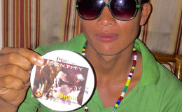 O' Neil d'Oliveira proudly displays the CD with his R&B song