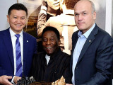 Football legend 'King' Pelé is flanked by the President of the World Chess Federation (FIDE) Kirsan Ilyumzhinov at left, and President of the Russian Federation and FIDE Vice-President Andrei Filatov recently in London at the 'Pelé: Art, Life, Football' exhibition. The FIDE president presented Pele with a Kalmyk chess set.