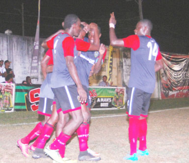 Alpha United's Delon Lanferman (centre) is being congratulated by team-mates Sherwin Skeete, Daniel Wilson and Anthony Belfield after scoring the opening goal during his team's 2-0 win over Fruta Conquerors in the GFF Stag Beer Elite League