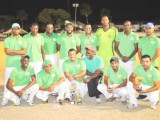The victorious Media XI cricket team after they defeated the Floodlight Masters Friday night in a memorial match for the late sports journalist Calvin Roberts.